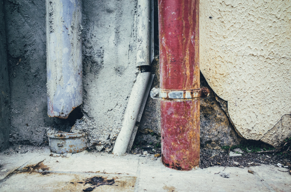 Broken and decaying pipes and walls.