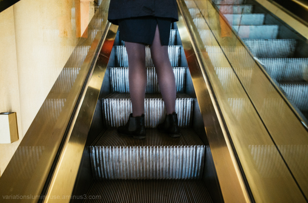 Ankle boots on escalator.