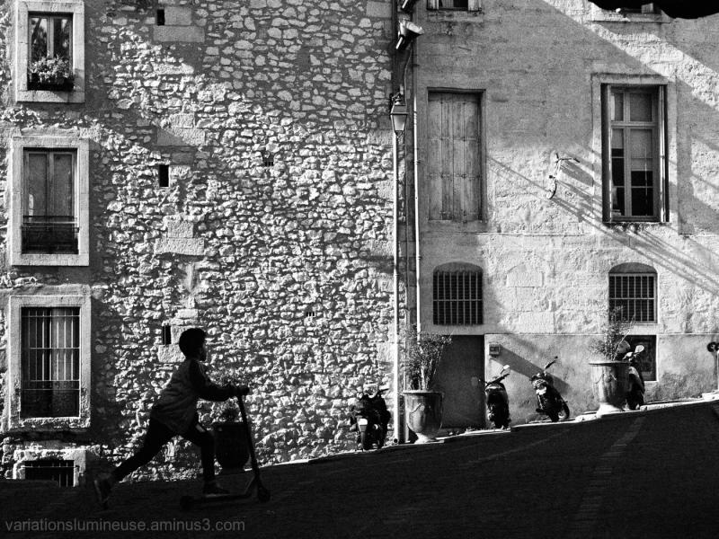 Children having fun street scene in b&w.