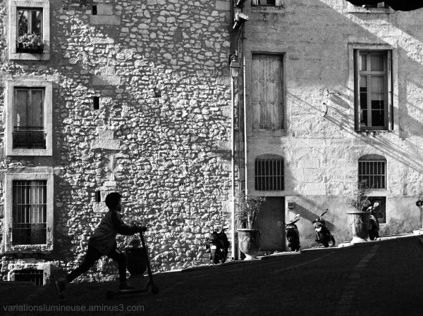 Children having fun street scene in b&w.