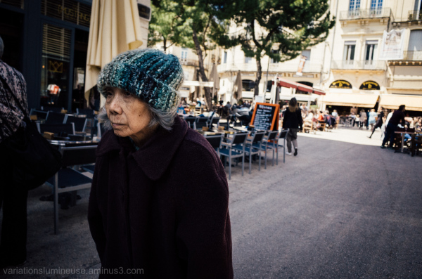 Older woman walking on the street.