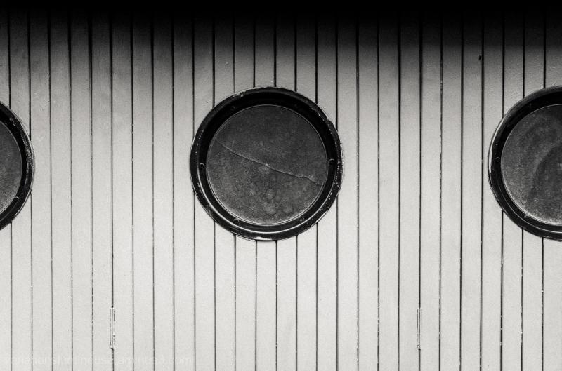 Garage doors round windows.