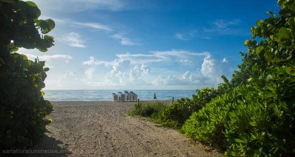 Man doing yoga on the beach in Miami, Florida.