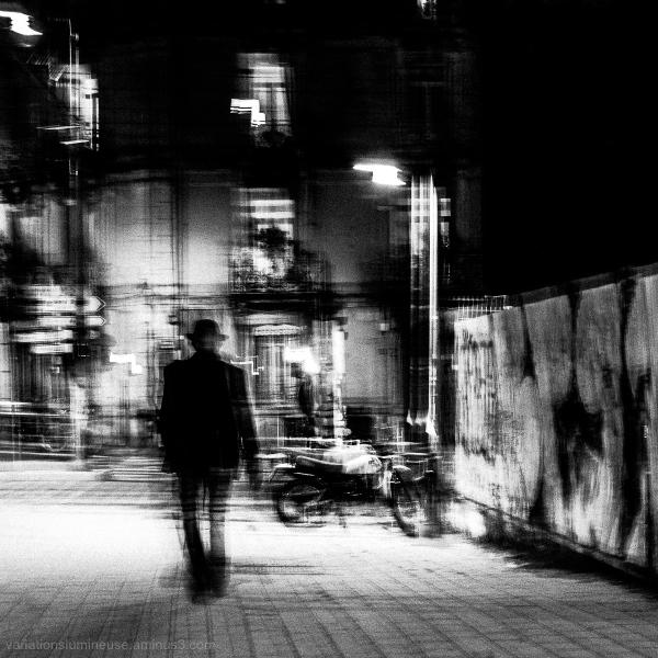 Blurred black and white night street shot.