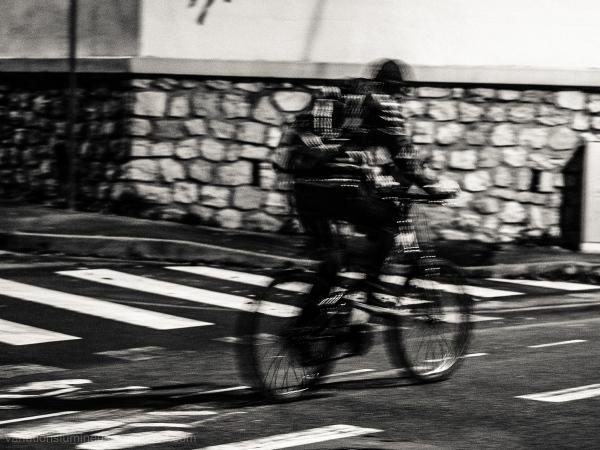 Riding his bike at night.