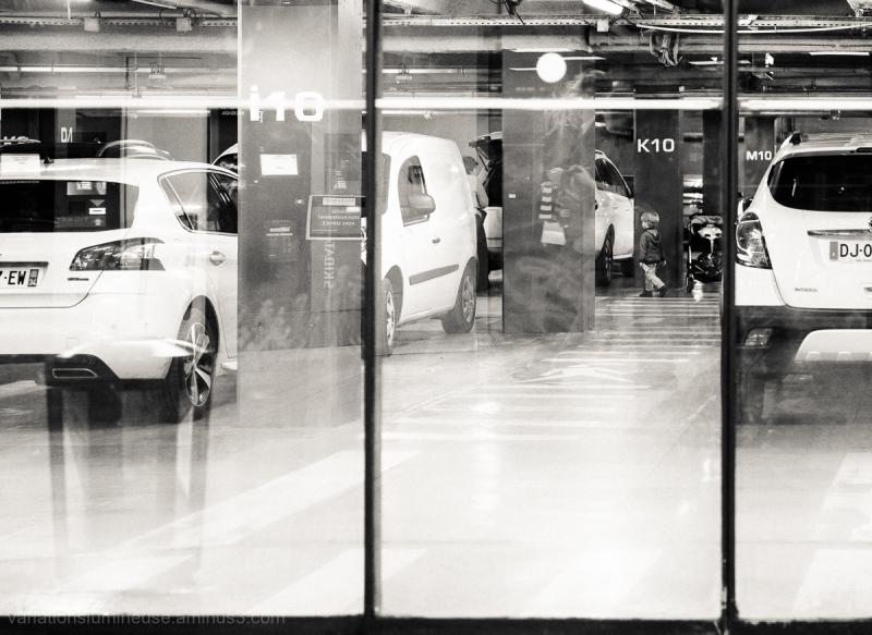 Family in garage shot through windows.
