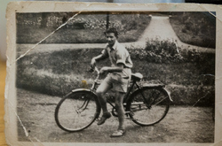 Father with bicycle.