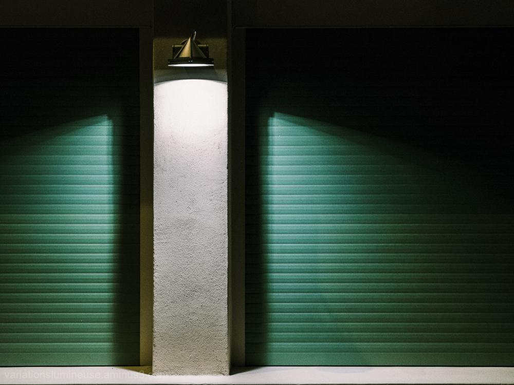 Green shuttered windows