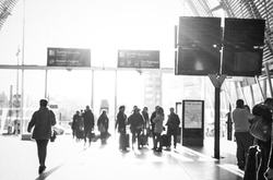 Travelers in a french train station.