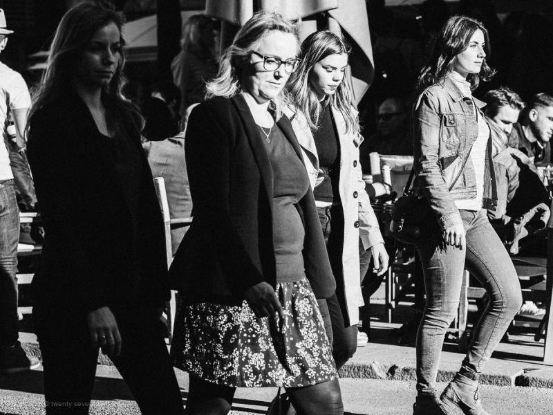 Women and men on street, Montpellier France.
