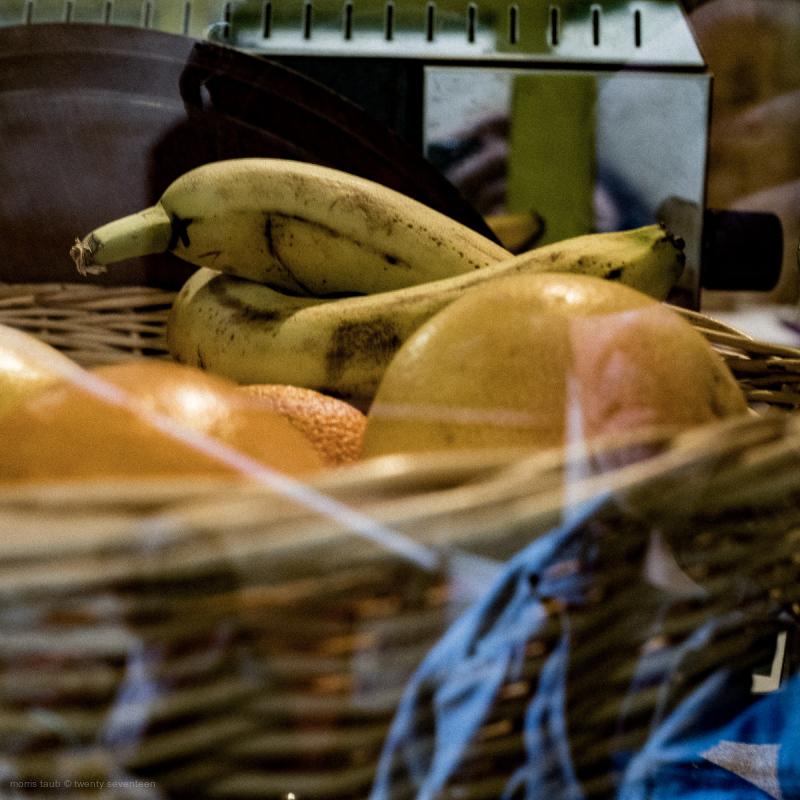 Basket of fruit in a store window.