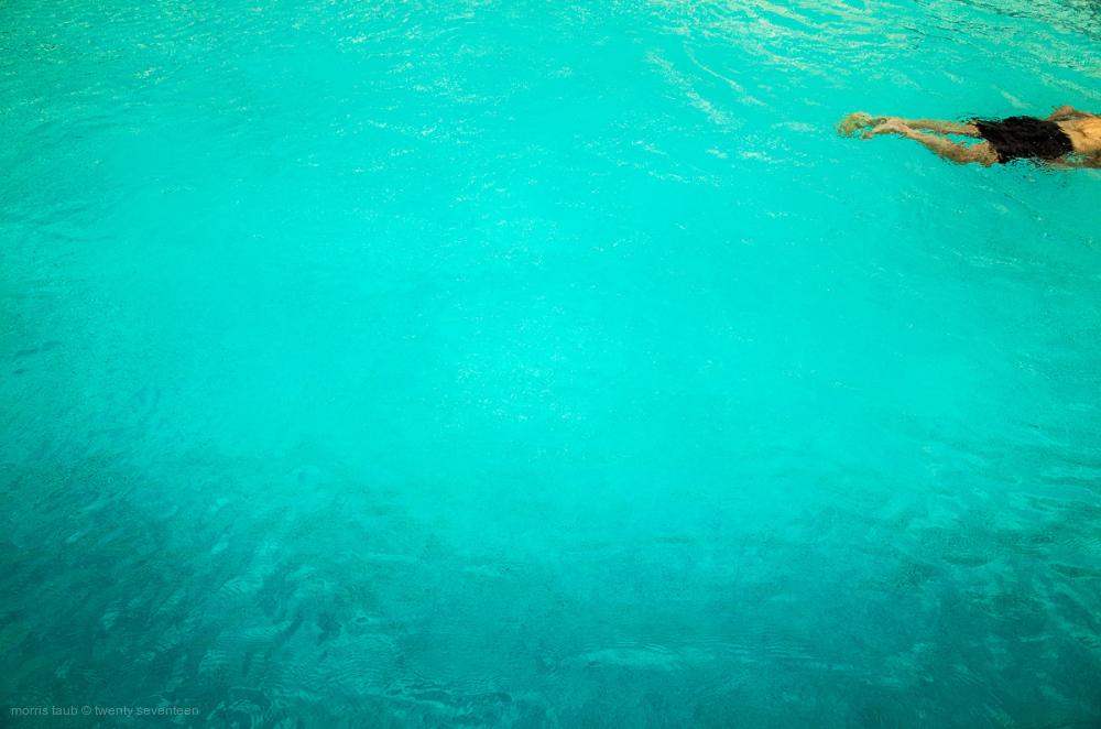 Man swimming. Miami Beach, Florida pool.