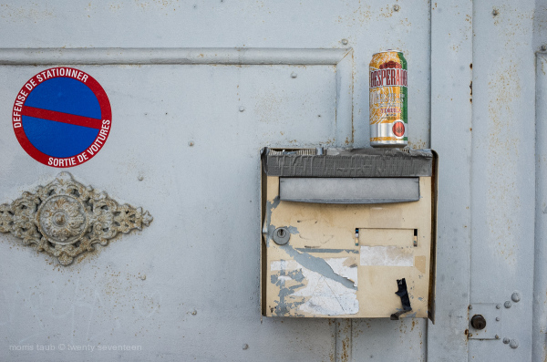 Old battered mailbox and can desperado.