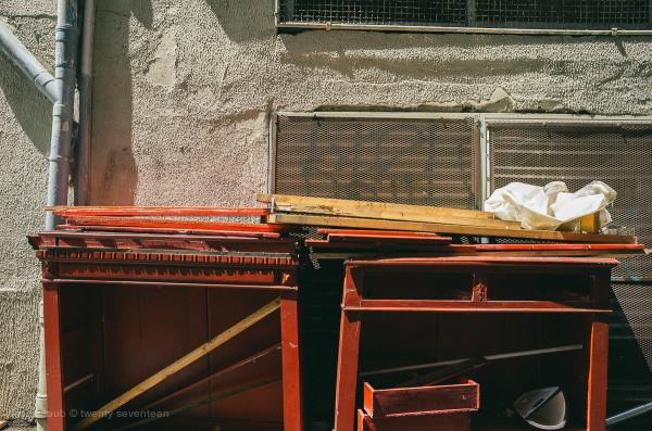 Red broken furniture in sunlight.