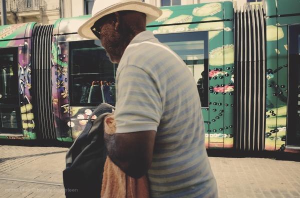 Man walking and tram tramming.