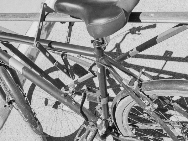 Chained up bike in black and white.