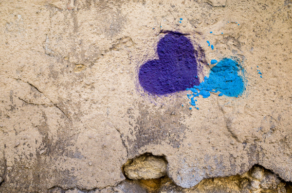 Hearts in purple and blue on a wall.