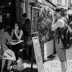 Woman checking out the menu at restaurant.