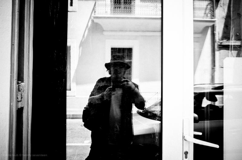 Self-portrait in window.