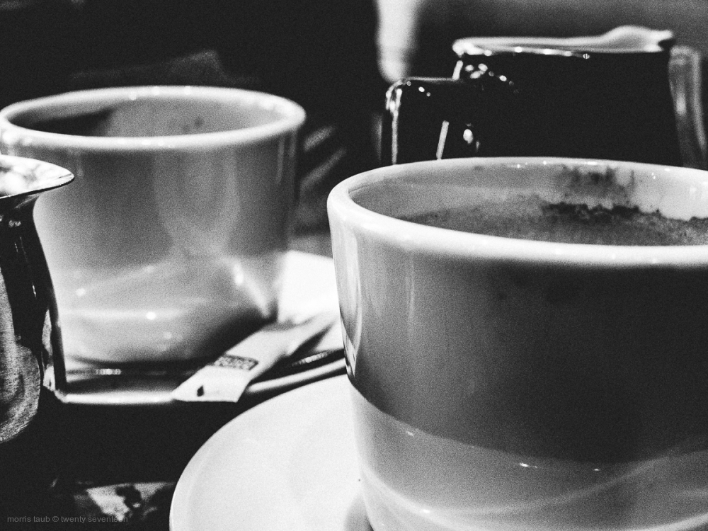 Two mugs at the cafe latitude.