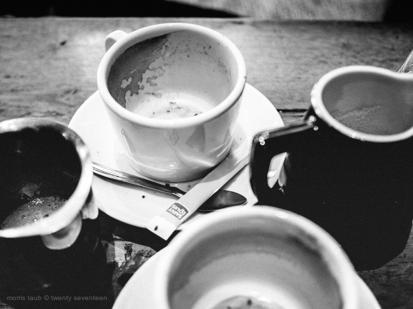 Coffee and milk on cafe table in France.