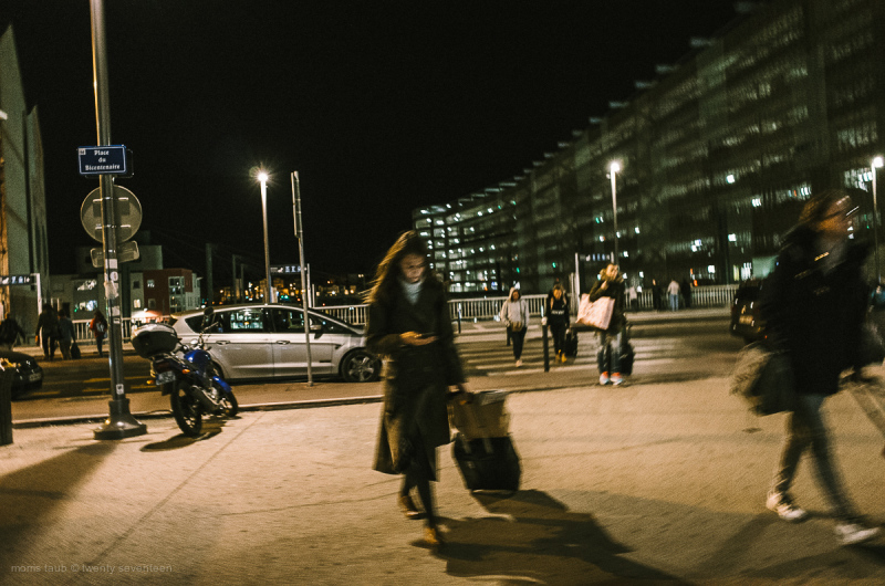 Woman heading into the train station. Nightime.