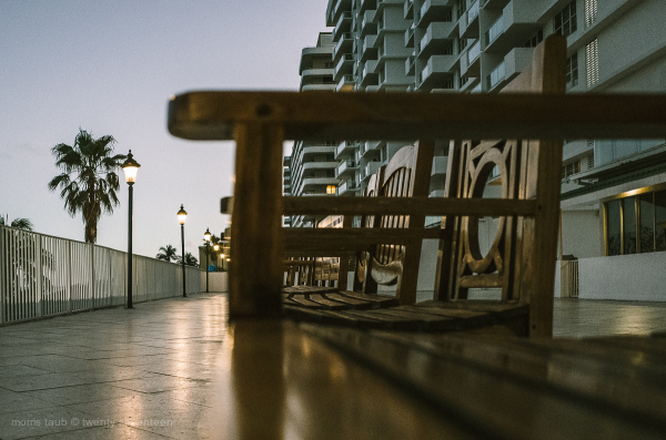 Wood chairs facing the sea, winter, Miami Beach.