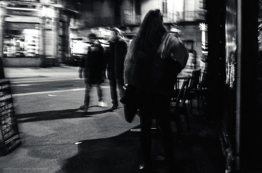 4 women on the street at night. BW.