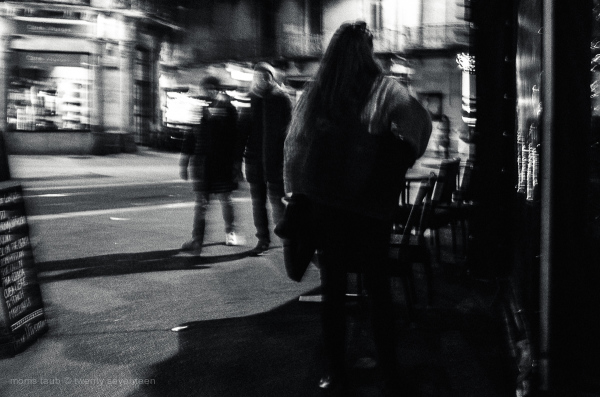 4 women on the street at night. BW.