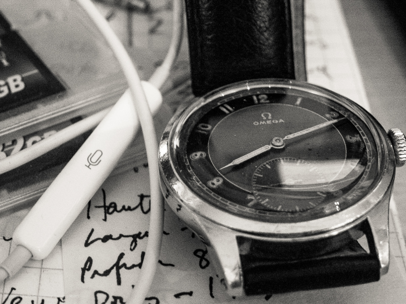 Desktop with macro of dad's old Omega.