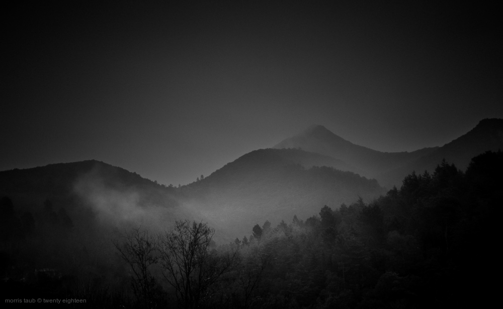 Mist on dark mountains in the Gard.