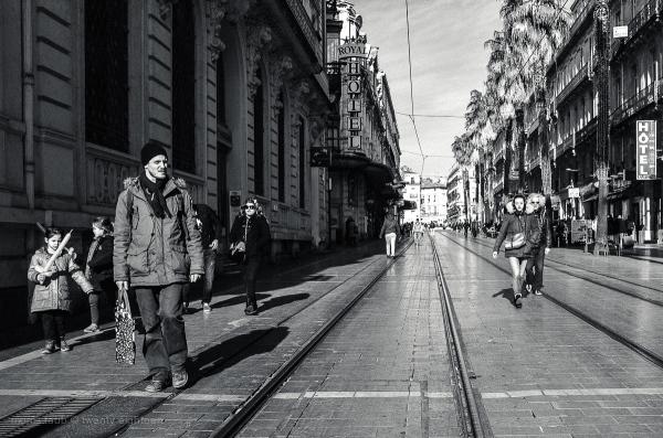 People walking in the sun.