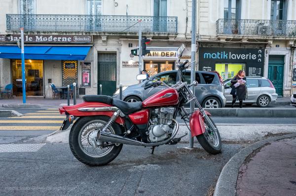 Street scene with Suzuki motorcycle.