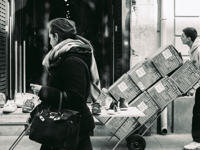 Sneakers being delivered. Black and white.