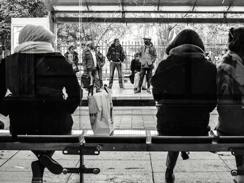 Commuters waitiing in black and white.