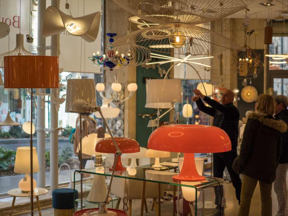 Lighting, fixture store with customers.