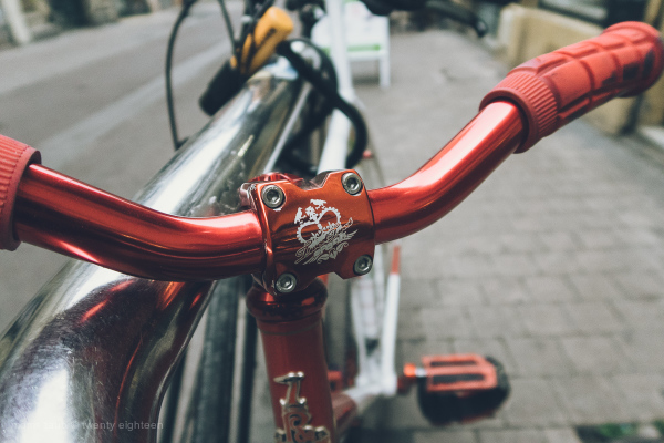 Bike locked up on the street.