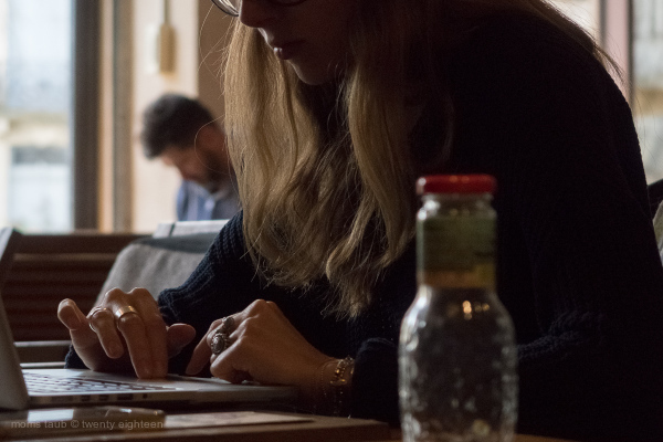 Young woman working a computer in cafe.