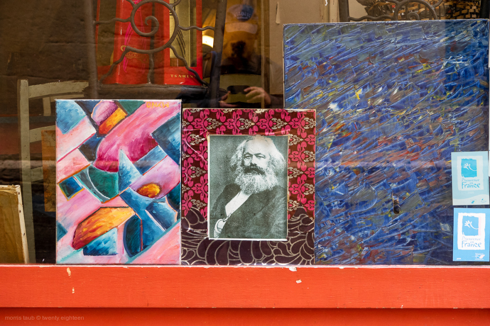 Karl Marx framed in store window.
