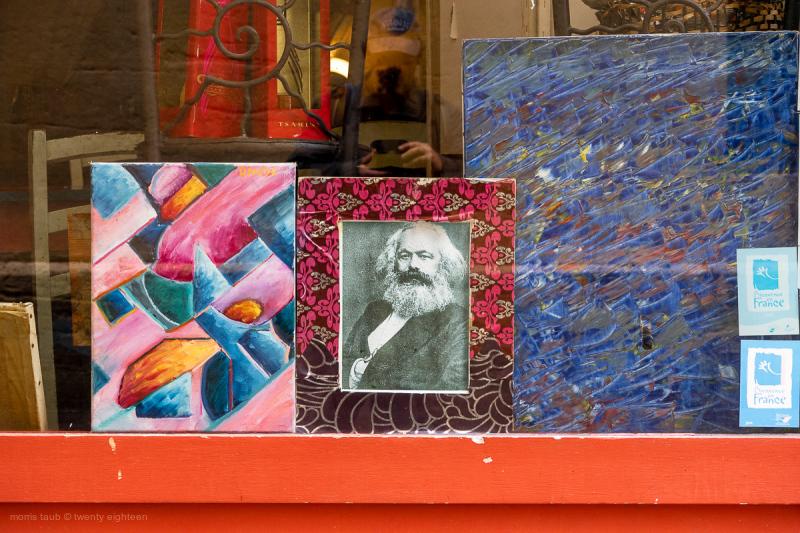 Karl Marx framed in store window.