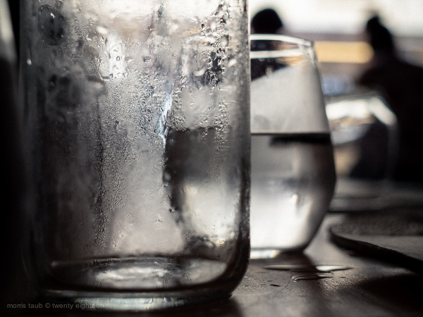 Cold glass of water in restaurant.