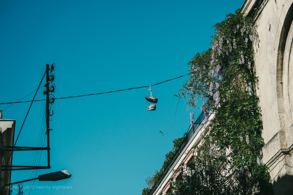 Sneakers on a wire. Street nostalgia.