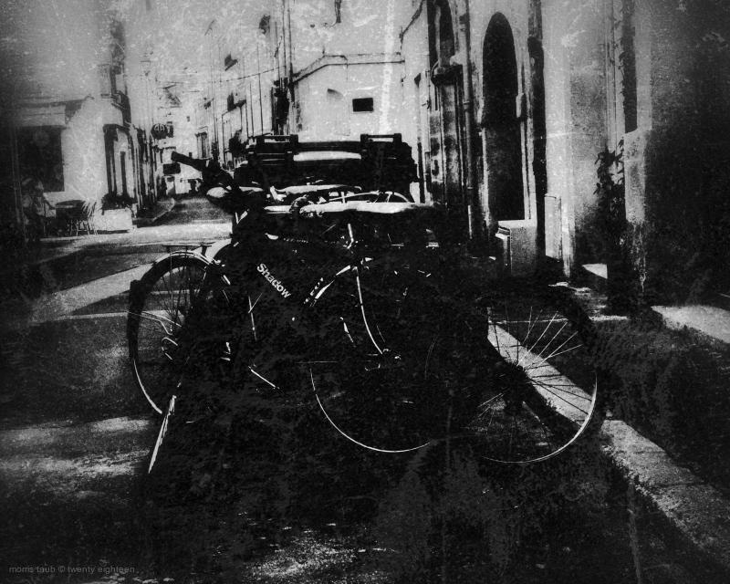Bikes locked up on the street.