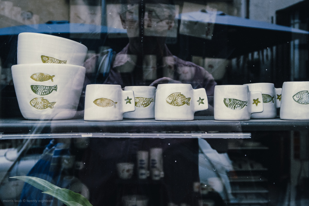 Fish on bowls, mugs, in store window.