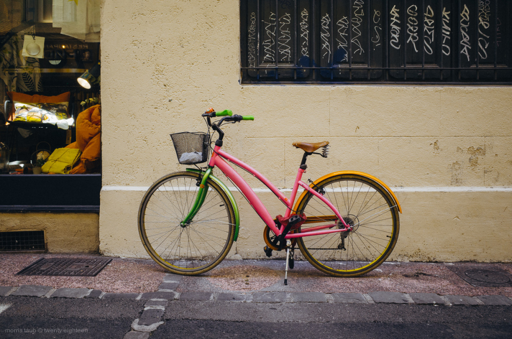 Multicolored bike on the street.