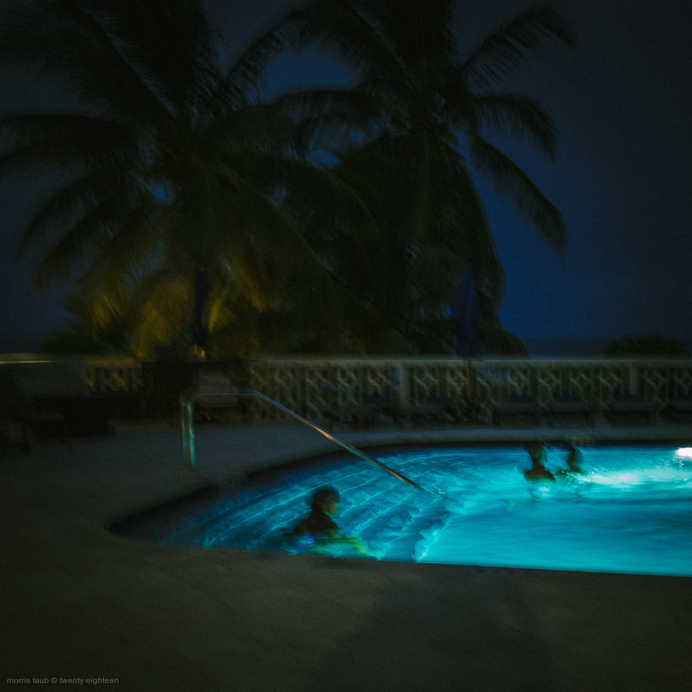 Swimming in the pool at night.