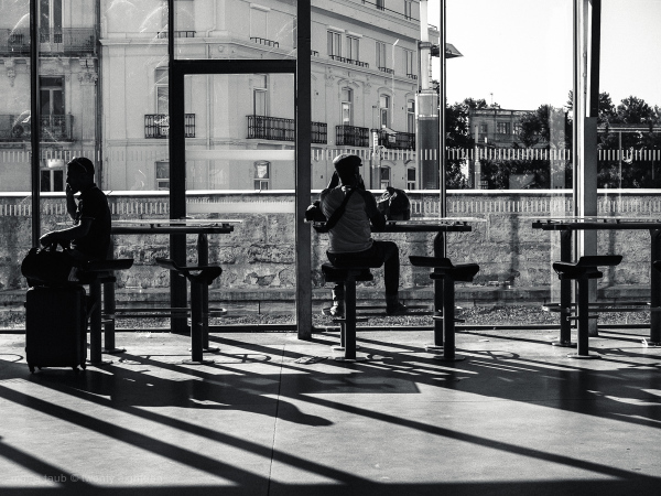 Two men waiting for a train.