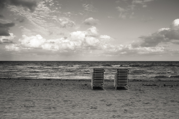 Chained lounge chairs on Miami Beach.