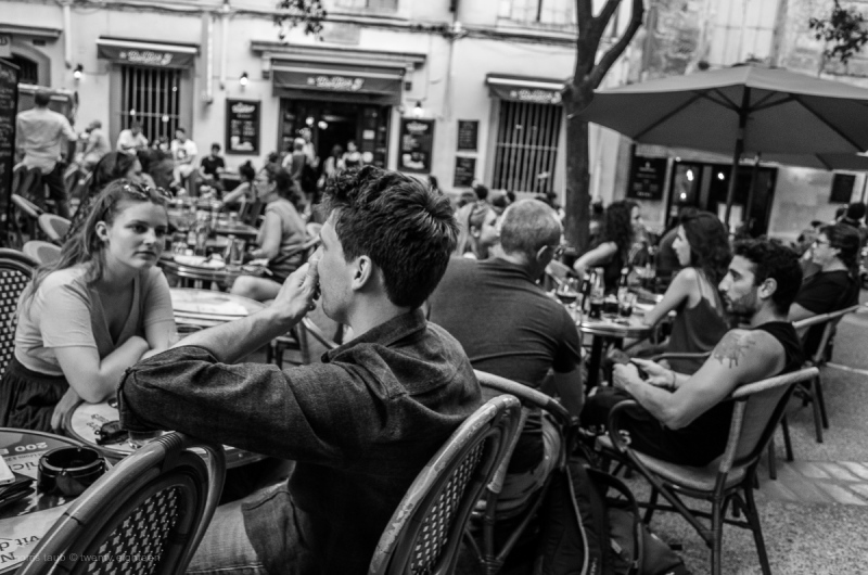 Crowded area people drinking and eating in France.