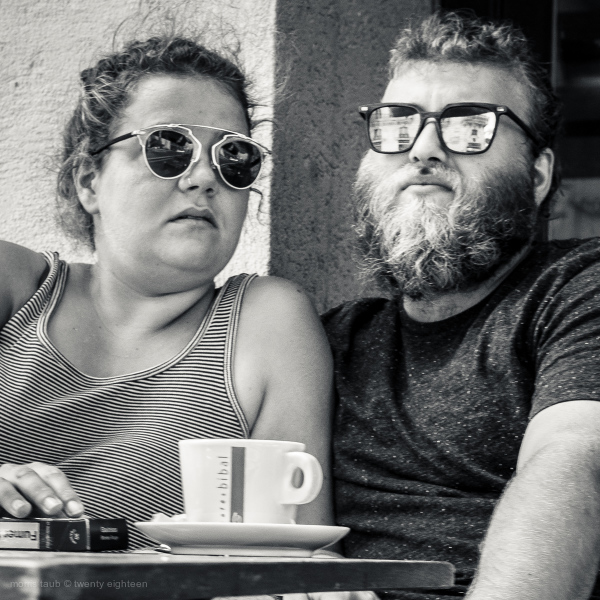 Couple having coffee and cigarettes.